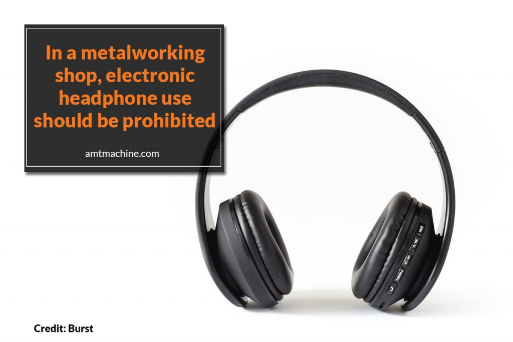 In a metalworking shop, electronic headphone use should be prohibited